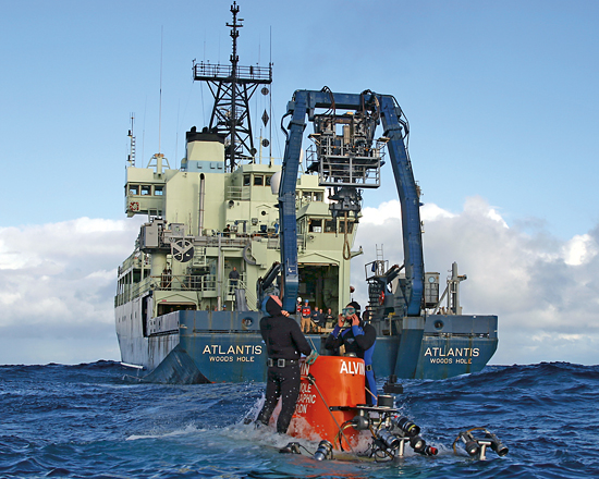 Trained divers (members of Alvin's team) assist with the sub's launch and recovery