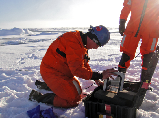 WHOI engineer Peter Koski from the Applied Ocean Physics and Engineering Department sets up a remote recording station on a small ice floe in the Fram Strait, between Greenland and Spitsbergen, Norway.