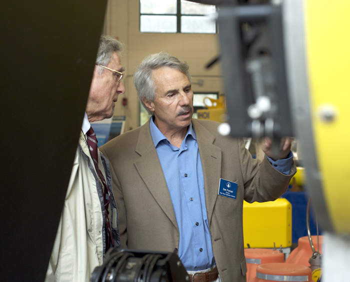DOEI Director Dan Fornari shows Life Trustee Peter McCormick some of the features of Nereus.