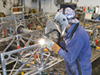 Lead Welder Geoffery Ekblaw working on the assembly of the HROV (Nereus) frame in the welding shop.