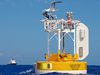 The WHOTS III buoy off Hawaii with the R/V Revelle in background.