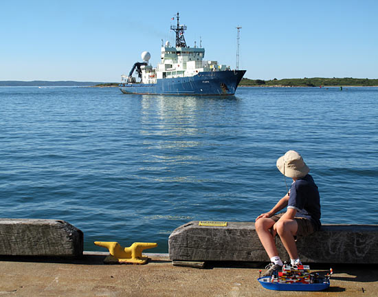 Boy waiting to greet Atlantis with Lego model
