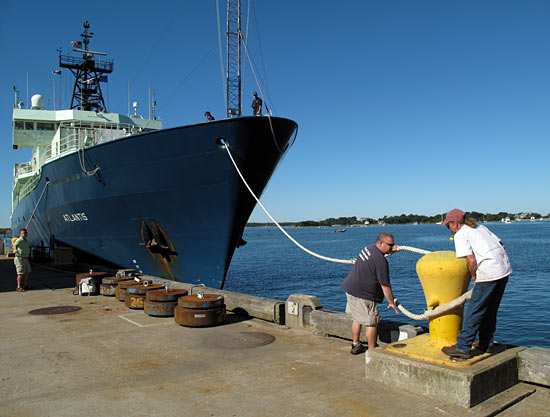 WHOI dock workers make the bow of Atlantis fast