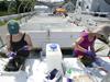 student Jen Reeve and chemist Amanda Spivak collect samples