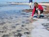 Ginny Edgcomb at shoreline in Australia