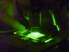 microscope slide under a fluorescence microscope