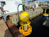 Putting Environmental Sample Processor into test well