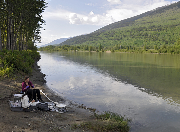 MIT/WHOI Joint Program graduate students Britta Voss (back) and Sarah Rosengard (front) sample the Fraser River at McBridge in the upper reaches of the Rocky Mountain Trench in June 2011.