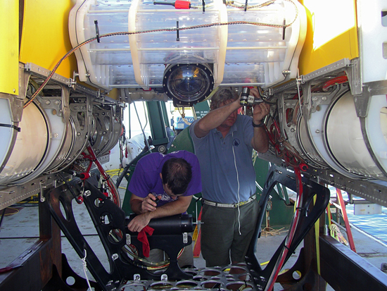 Casey Machado and Bob McCabe prepare the new hybrid remotely operated vehicle for deployment