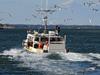 Fishing boat leaves Chatham Harbor