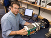 Rich Camilli in the lab with Gemini, his miniature mass spectrometer.