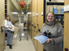 Ann Devenish and Ellen Levy working in the WHOI Data Library/Archives.