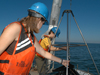 2007 Summer Student Fellows Tess Brandon and Kelsey Winsor deploy a box corer off the stern of R/V Tioga.