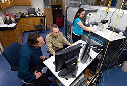 Ken Sims, Bernhard Peucker-Ehrenbrink, and Tracy Atwood working in the ICP facility