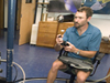 Matt Heintz demonstrating new HROV manipulator arm.