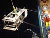 Researchers on R/V Oceanus deploy a sampling sled.