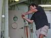 DSV Alvin pilot Anthony Tarantino practices for the summer baseball season aboard the R/V Atlantis.