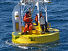Crew repairing the gulf stream buoy in the water.