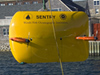 AUV Sentry is lowered into the water for tests.