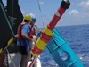 Researchers retrieve a sediment trap mooring with a ?holey sock? drogue