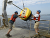 Postdoc Dave Ralston and Jay Sisson recover a mooring bouy.