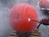 John Kemp powerwashing the mooring spheres.