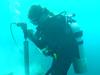 Diver underwater coral coring in Honduras