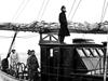 Captain Adrian K. Lane standing on the wheelhouse of R/V Atlantis, circa 1946.