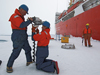 John Kemp (standing) with Kris Newhall prepare to drill a hole in the ice in the Beaufort Sea