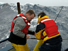 John Lund and Bob Weller deploy an APEX float off R/V Oceanus during rough weather.