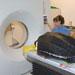 darlene ketten examines turtle at CT scanner