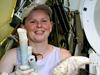 Rhiann Waller holding a bundle of tubeworms.