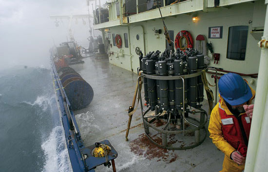 WHOI engineer Craig Marquette secures the door to the wet lab after recovery of a CTD (on deck).