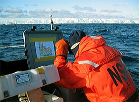 Greg Packard studies a bathymetry chart
