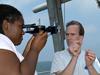 Tioga Captain Ken Houtler teaching Summer Student Fellow DeAnna McCadney how to use a sextant.