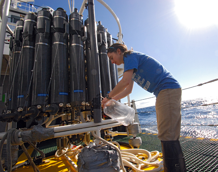 WHOI's Laura Sofen assists with water sampling during a recent cruise to the North Atlantic led by Associate Scientist Benjamin Van Mooy.