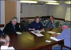 First                          science meeting in the board room. From left: Doug Seiberg                          (IOS), Sarah Zimmermann (IOS), Waldeck Walczowski (IOS),                          and John Kemp (WHOI).