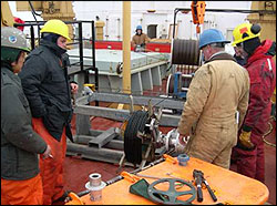 Using a specially designed dual capstan winch to reel in over 3000 m of mooring wire rope cable.