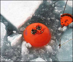 Spherical top float being recovered in the ice.