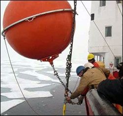 Top flotation sphere being attached at the end of the deployment.
