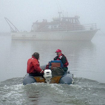 On a gray day in August 2006, WHOI research associate Phil Alatalo (right) and Captain Bill Kopplin motored out to the R/V Annika Marie at Barrow, Alaska.