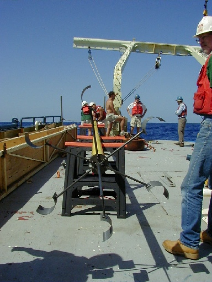 WHOI/Webb Research shear meters being prepared and launched from Oceanus.   East of Barbados in the the area of the Guiana Abyssal Gyre Experiment of Mike McCartney, 20 Feb 2001.  Personnel who can be seen are Tim Duda  (green shirt), Richard Limeburner (no shirt), Ryan Schrawder (blue shirt), Claudia Cenedese (green shirt and shorts), and Jeff Stolp (bosun, shades, standing at his customary spot at the A-Frame)