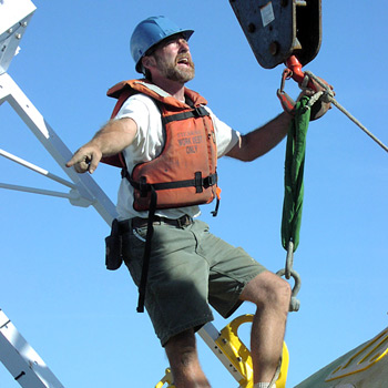 Jeff Lord, a WHOI senior engineering assistant, directs the deployment of the WHOI Hawaii Ocean Timeseries Station II buoy.