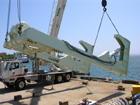 The Allied A-frame being hoisted for installation on Knorr at the WHOI Iselin Marine Facility.