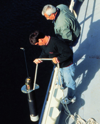 Argo float being deployed over the rail of a small vessel.