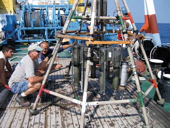 Aboard the Bulgarian R/V Akademik, research specialist Alan Gagnon (in the hat) and Bulgarian scientists inspect Niskin bottles during a Black Sea cruise with Assistant Scientist Marco Coolen.