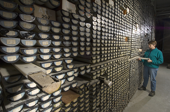 Assistant Curator Ellen Roosen examines cores in the WHOI Seafloor Samples Laboratory.