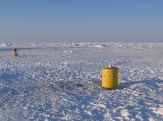 Shortly after deployment 175 miles upstream of Russian ice camp Barneo, ITP 47 rests on the 3.5 m thick ice flanked by AOFB on left and barely visible IMB on the right. (Rick Krishfield)