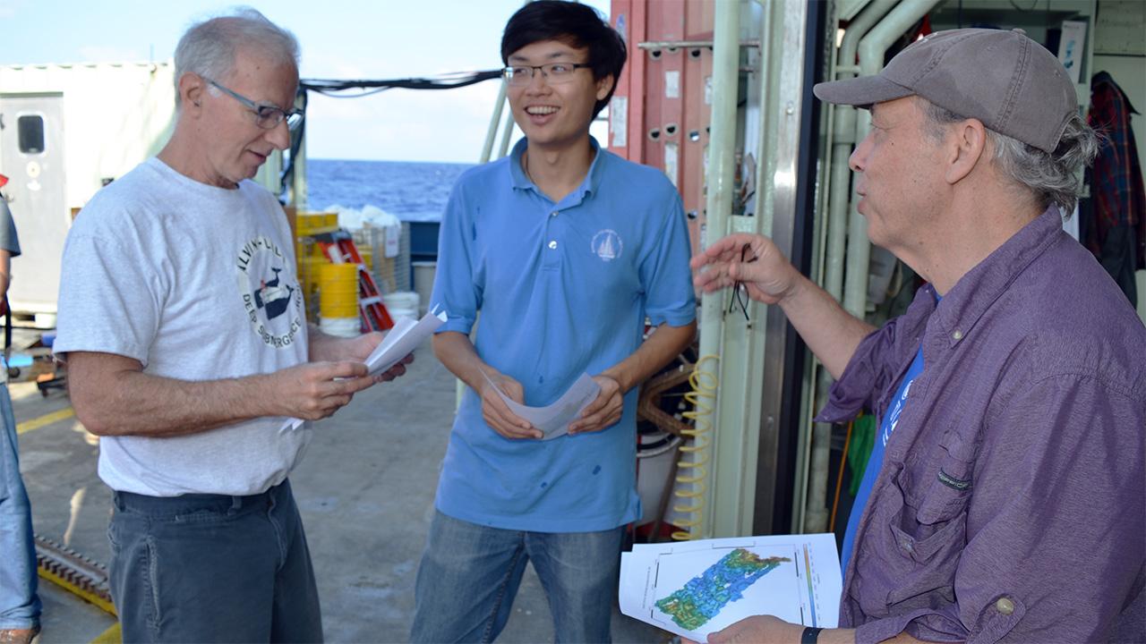 Dana Yoerger distributes seafloor maps.