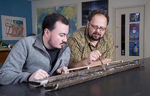 Camilo Ponton and Liviu Giosan with sediment core